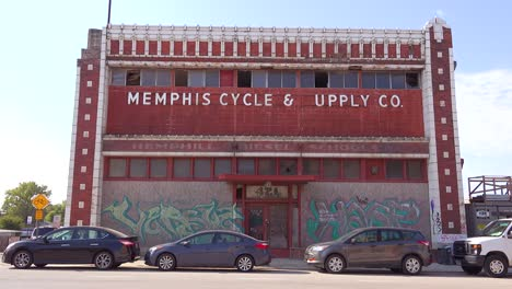 Establishing-shot-of-abandoned-cyle-and-supply-storefront-in-the-business-district-of-Memphis-Tennessee