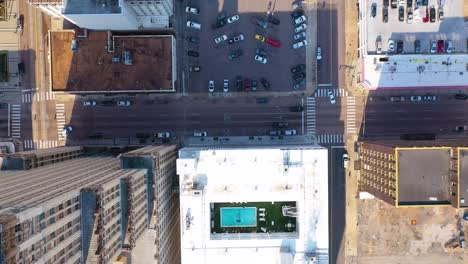 Aerial-looking-straight-down-tilt-up-of-urban-city-downtown-business-district-buildings-streets-Memphis-Tennessee