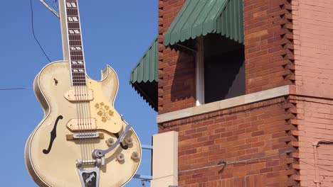 Establishing-shot-of-Sam-Phillips-Sun-Recording-studio-with-guitar-hanging-outside-in-Memphis-Tennessee-1