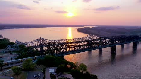 Aerial-of-landmark-three-steel-bridges-over-the-Mississippi-River-at-sunset-with-Memphis-Tennessee-background