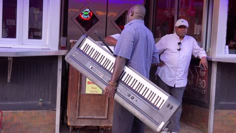 A-musician-carries-a-keyboard-to-a-gig-on-Beale-Street-Memphis-Tennessee