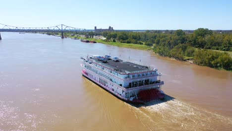 Beautiful-aerial-shot-of-a-paddlewheel-steamboat-luxury-cruise-ship-on-the-Mississippi-River-near-West-Helena-Arkansas-1