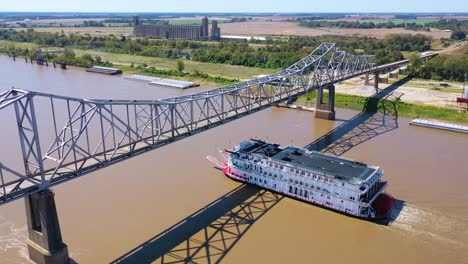 Beautiful-aerial-shot-of-a-paddlewheel-steamboat-luxury-cruise-ship-on-the-Mississippi-River-near-West-Helena-Arkansas-2