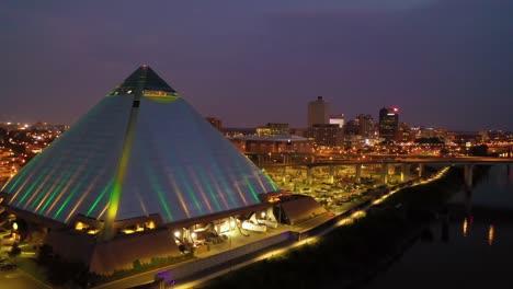 Beautiful-night-aerial-shot-of-the-Memphis-pyramid-Hernando-De-Soto-Bridge-and-cityscape-at-dusk-2