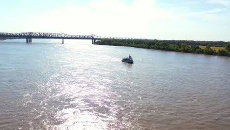 Good-aerial-of-a-paddlewheel-steamboat-riverboat-moving-up-the-Mississippi-River-with-Memphis-Tennessee-in-the-background-1