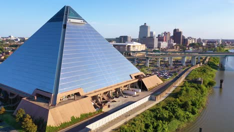 Rising-aerial-shot-of-the-Memphis-pyramid-and-downtown-business-district-of-Memphis-Tennessee-is-background