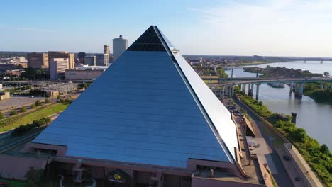 Good-aerial-shot-of-the-Memphis-pyramid-and-downtown-business-district-of-Memphis-Tennessee-is-background
