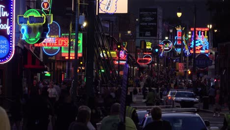 Establishing-night-and-crowds-on-Beale-Street-Memphis-Tennessee-with-neon-signs-bars-and-clubs