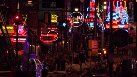 Establishing-night-and-crowds-on-Beale-Street-Memphis-Tennessee-with-neon-signs-bars-and-clubs-1