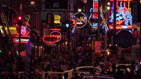 Establishing-night-and-crowds-on-Beale-Street-Memphis-Tennessee-with-neon-signs-bars-and-clubs-2