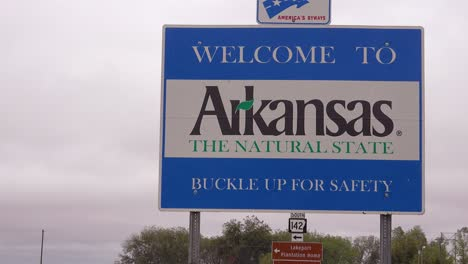 A-road-sign-welcomes-visitors-to-the-state-of-Arkansas