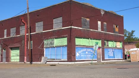 An-old-abandoned-building-stands-in-a-dusty-and-run-down-small-town-in-Mississippi-America