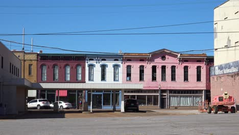 People-walk-through-a-rundown-and-poverty-stricken-abandoned-America-town-in-Mississippi