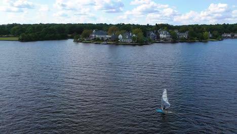 Aerial-over-kite-boarder-near-luxury-homes-real-estate-and-mansions-on-Ross-R-Barnett-Reservoir-near-Old-Trace-Park-Jackson-Mississippi