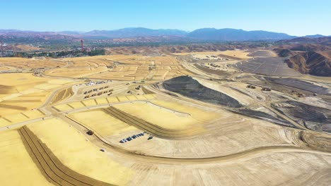 Aerial-over-a-massive-vast-giant-tract-home-contruction-project-development-in-the-hills-above-Santa-Clarita-California-suggests-Los-Angeles-urban-sprawl-6