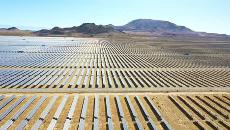 Side-view-drone-aerial-of-vast-solar-array-in-Mojave-Desert-California-suggests-clean-renewable-green-energy-resources