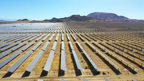 Side-view-drone-aerial-of-vast-solar-array-in-Mojave-Desert-California-suggests-clean-renewable-green-energy-resources-1