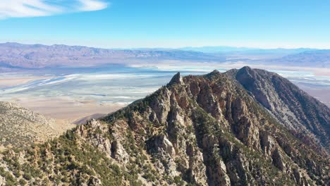Aerial-over-stone-mountaintop-along-a-ridge-in-the-Eastern-Sierra-mountains-near-Lone-PIne-and-the-Owens-Valley-california