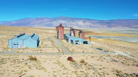 Aerial-over-an-abandoned-glass-factory-plant-along-highway-395-at-Owens-Lake-Owens-Valley-California