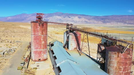 Aerial-over-an-abandoned-glass-factory-plant-along-highway-395-at-Owens-Lake-Owens-Valley-California-1