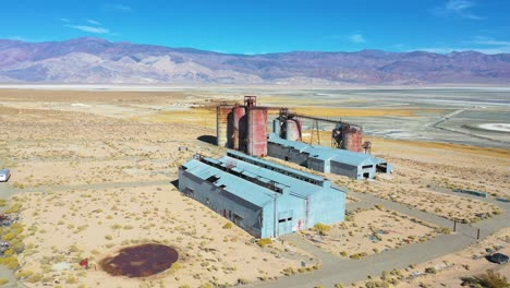 Aerial-over-an-abandoned-glass-factory-plant-along-highway-395-at-Owens-Lake-Owens-Valley-California-2