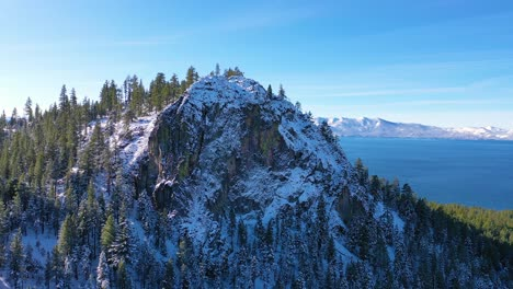 2020--beautiful-revealing-aerial-of-Lake-Tahoe-from-behind-a-snowy-mountain-peak