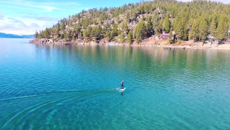 2020---a-man-rides-a-hydrofoil-efoil-electronic-surfboard-across-Lake-Tahoe-California-in-an-extreme-hydrofoiling-foil-sport-demonstration