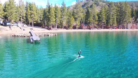 2020---a-man-rides-a-hydrofoil-efoil-electronic-surfboard-across-Lake-Tahoe-California-in-an-extreme-hydrofoiling-foil-sport-demonstration-2
