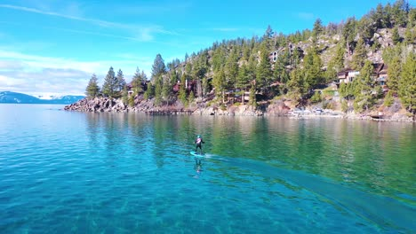 2020---a-man-rides-a-hydrofoil-efoil-electronic-surfboard-across-Lake-Tahoe-California-in-an-extreme-hydrofoiling-foil-sport-demonstration-3
