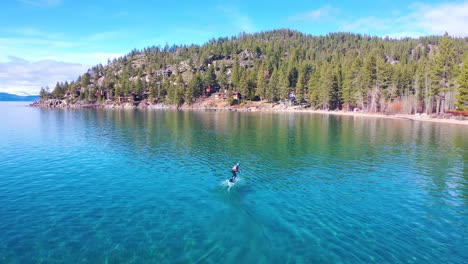2020---a-man-rides-a-hydrofoil-efoil-electronic-surfboard-across-Lake-Tahoe-California-in-an-extreme-hydrofoiling-foil-sport-demonstration-5