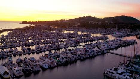 2020---dusk-or-twilight-aerial-over-Santa-Barbara-harbor-with-many-boats-at-dock