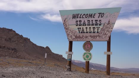 2020---establishing-shot-welcome-sign-to-Searles-Valley-in-the-Mojave-Desert-near-Trona-California
