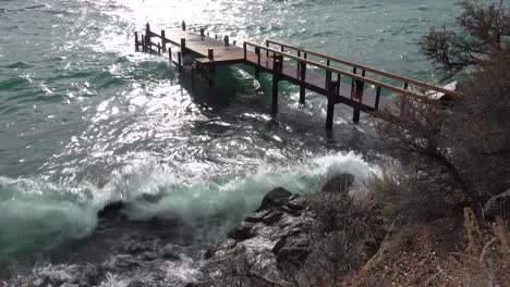 Huge-waves-crash-into-a-pier-and-shore-on-the-banks-of-Lake-Tahoe-during-a-big-winter-storm-1