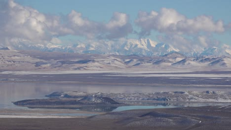 Time-lapse-beautiful-panoramic-shot-of-snow-covered-winter-mountains-in-the-Eastern-Sierra-Nevada-mountains-and-Mono-Lake-California