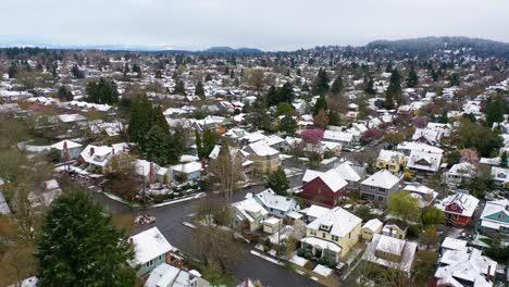 Aerial-over-snowy-winter-neighborhood-houses-suburbs-in-snow-in-Portland-Oregon-1