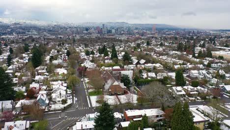 Aerial-over-snowy-winter-neighborhood-houses-suburbs-in-snow-in-Portland-Oregon-2