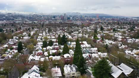 Aerial-over-snowy-winter-neighborhood-houses-suburbs-in-snow-in-Portland-Oregon-3