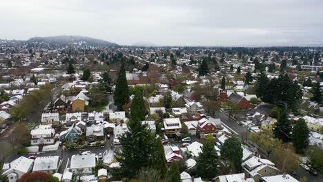 Aerial-over-snowy-winter-neighborhood-houses-suburbs-in-snow-in-Portland-Oregon-4