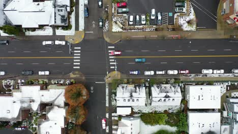 Top-down-aerial-over-snowy-streets-and-cars-in-suburbs-in-snow-in-Portland-Oregon