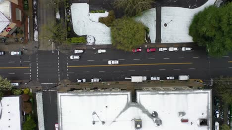 Top-down-aerial-over-snowy-streets-and-cars-in-suburbs-in-snow-in-Portland-Oregon-1
