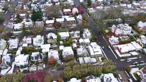 Aerial-tilt-up-over-snowy-winter-neighborhood-houses-suburbs-in-snow-in-Portland-Oregon