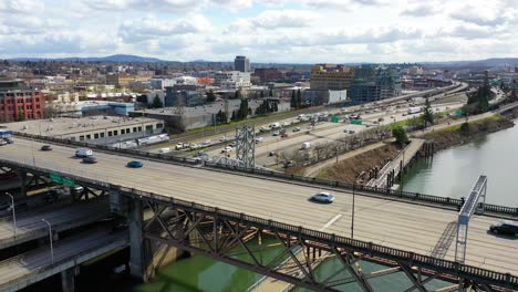 High-angle-aerial-shot-of-freeway-traffic-Amtrak-train-and-Willamette-River-in-Portland-Oregon-1