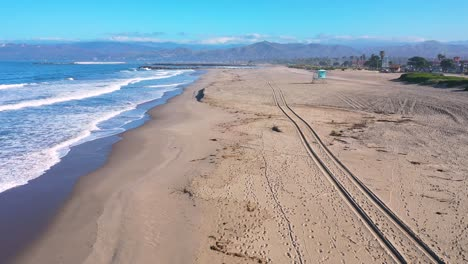2020---aerial-of-closed-lifeguard-station-and-abandoned-beaches-of-Ventura-southern-california-during-covid-19-coronavirus-epidemic-as-people-stay-home-en-masse-1