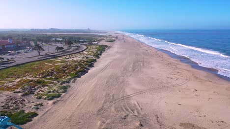 2020---aerial-of-closed-lifeguard-station-and-abandoned-beaches-of-Ventura-southern-california-during-covid-19-coronavirus-epidemic-as-people-stay-home-en-masse-2