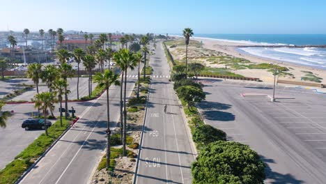 2020---aerial-of-lonely-biker-on-abandoned-roads-beaches-of-Ventura-southern-california-during-covid-19-coronavirus-epidemic-as-people-stay-home-en-masse