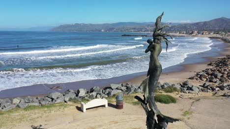2020---aerial-of-mermaid-statue-and-abandoned-beaches-of-Ventura-southern-california-during-covid-19-coronavirus-epidemic-as-people-stay-home-en-masse-2