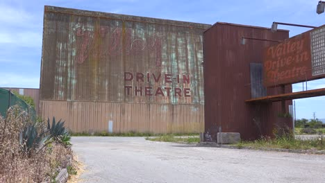 Establishing-shot-of-an-abandoned-drive-in-movie-theater-1