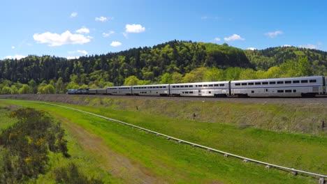 An-aerial-view-following-an-Amtrak-passenger-train