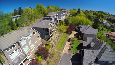 An-aerial-image-over-a-typical-american-suburban-street-and-condos-with-a-car-arriving-home