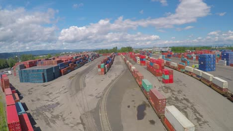 An-aerial-over-a-rail-freight-yard-with-containers-in-transit